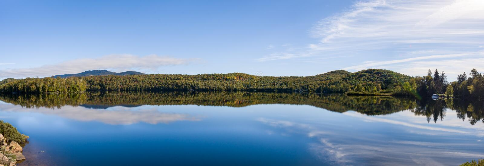 Mirror effect lake during fall in Mount Tremblant, Quebec, Canad stock photo
