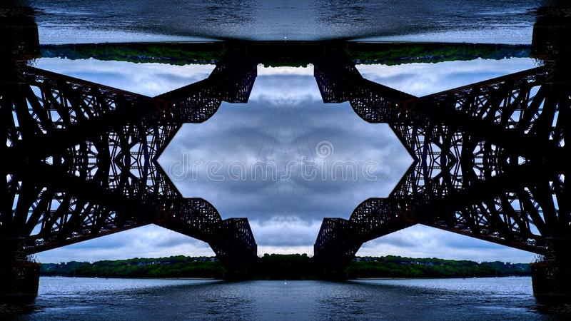Mirror effect on the Quebec Bridge. Over the St. Lawrence River, a cloudy day before a storm in Quebec Canada royalty free stock photography
