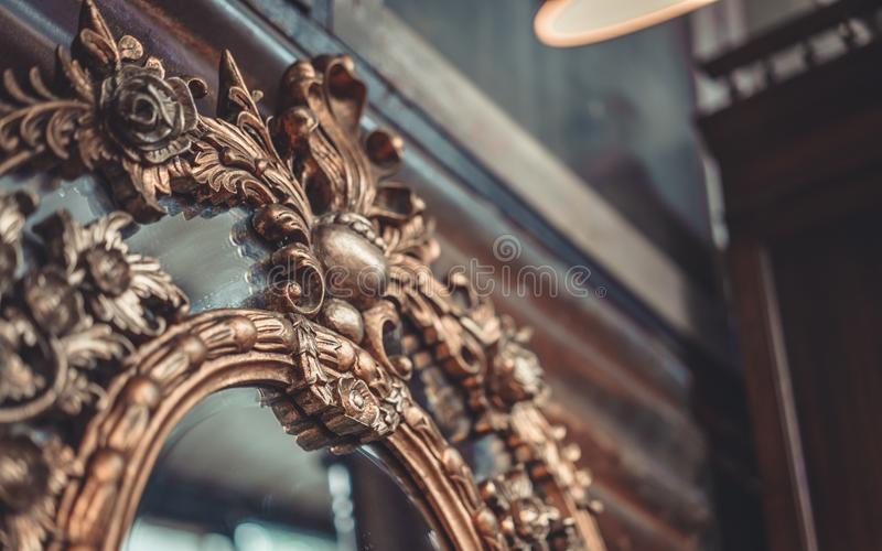 Mirror With Engraved Metal Frame. Mirror With Engraved Metal Brass Frame Vintage Old Collection Photo royalty free stock photos