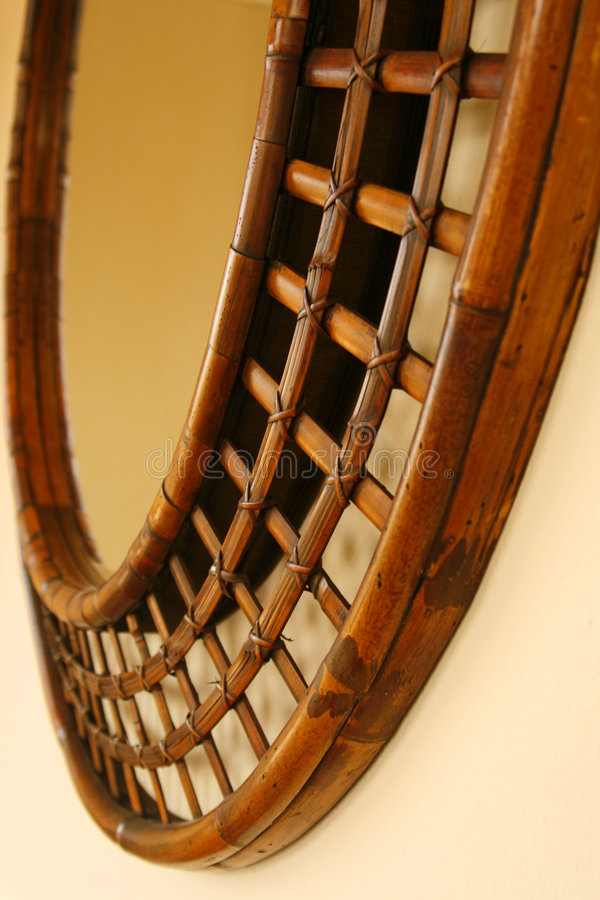 Mirror Frame. Selected area of round mirror frame made from bamboo canes woven together stock images