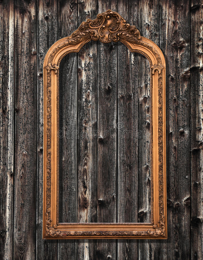 Mirror frame on a wooden wall. Classic mirror frame on a wooden wall stock images