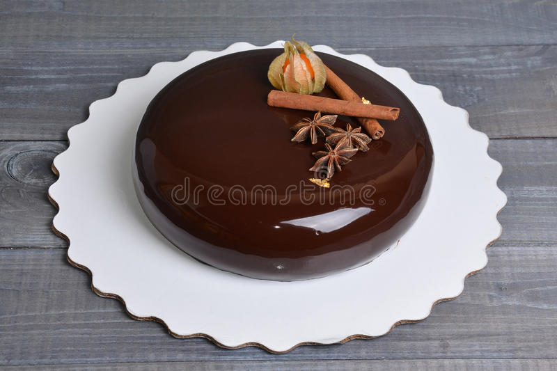 Mirror glaze chocolate mousse cake with decoration. A mirror glaze chocolate mousse cake with decoration royalty free stock photography