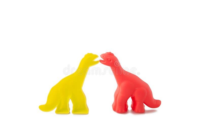 Mirror Image of Childrens Dinosaurs. Description: Two Mirror images of plastic childrens dinosaurs taken in the studio Location: Corsham, Wiltshire, UK stock image