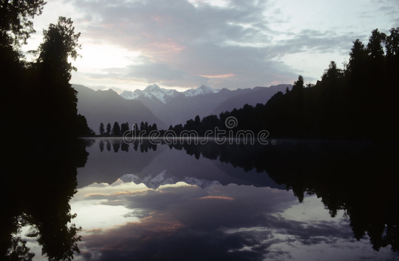 Mirror Lake. Lake Matheson with Mt. Cook and Mt. Tasman, Westland National Park, New Zealand royalty free stock images