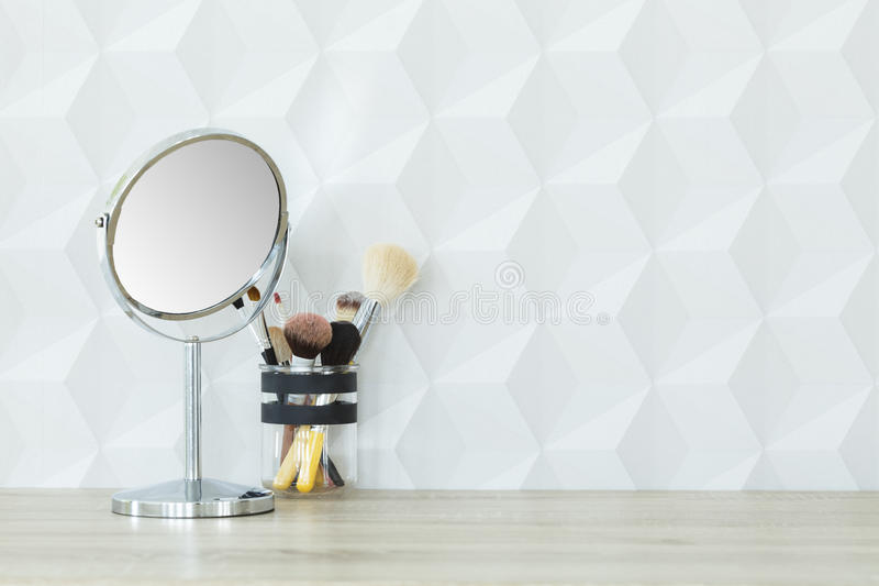 Mirror and makeup brushes stock photography