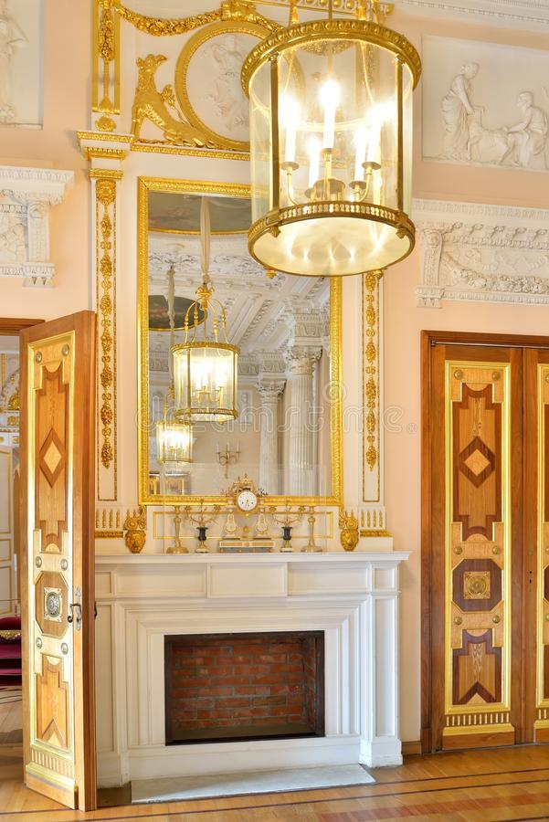 The mirror on the mantelpiece in the Marble dining room in Gatchina Palace royalty free stock photography