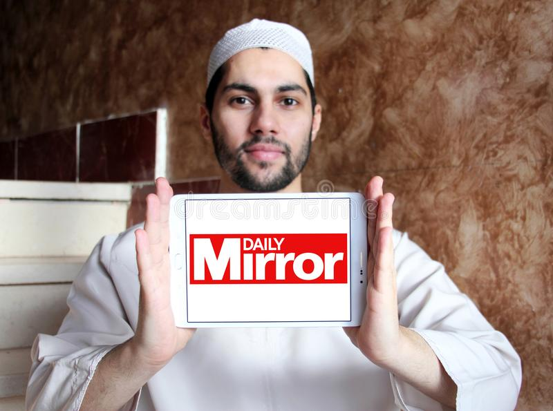 Daily Mirror newspaper logo. Logo of Daily Mirror newspaper on samsung tablet holded by arab muslim man. The Daily Mirror is a British national daily tabloid stock photography