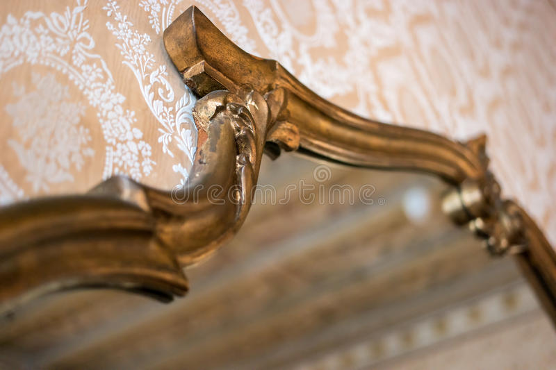 Mirror in old gilded frame. stock photos
