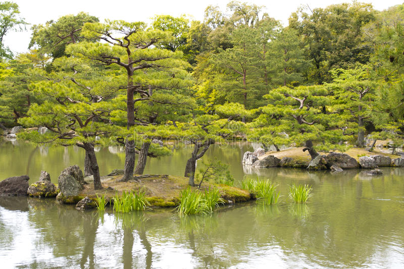 Mirror Pond at Kinkaku-ji Temple in Kyoto. Kyoko-chi or Mirror Pond which contains 10 small islands at Kinkaku-ji temple in Kyoto stock photo