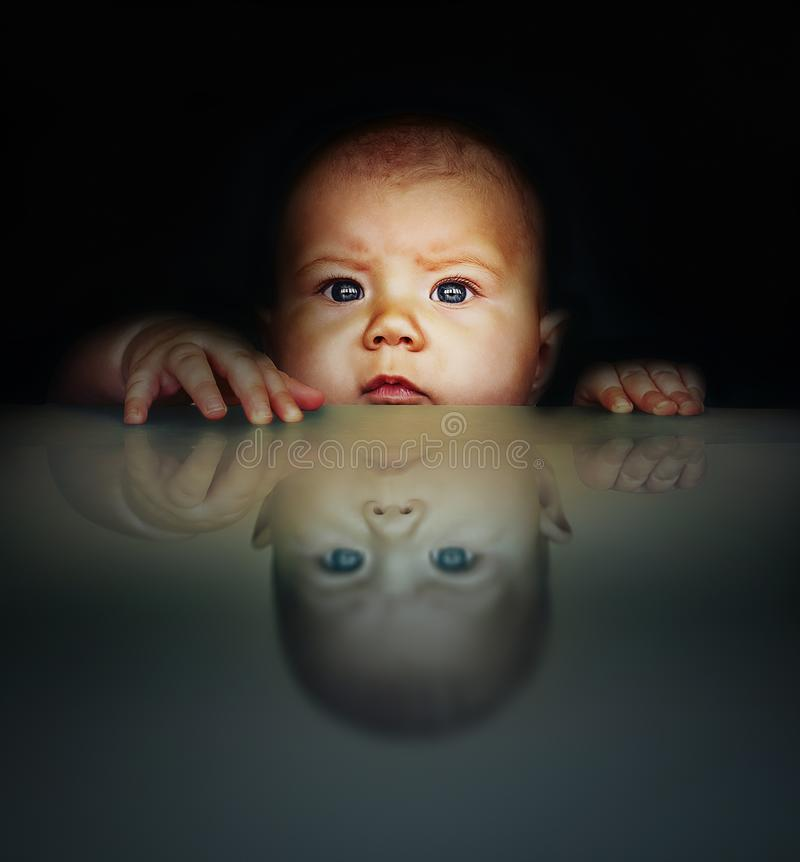Mirror portrait of a baby stock images