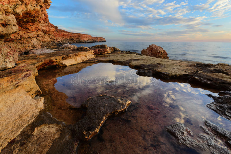 Mirror of reality. Majestic Sunset on the Cossack Bay. Sevastopol, Crimea royalty free stock photos