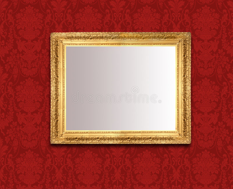 Mirror on red wall. An ornamental gold mirror on a wall of red Baroque wallpaper royalty free stock photography