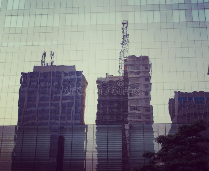mirror reflecting buildings royalty free stock photo
