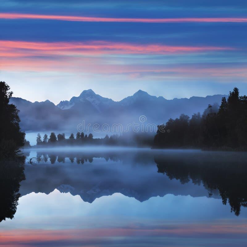 Mirror reflection Lake Matheson Aoraki Mount Cook, Mirror in Fox Glacier National Park New Zealand, natural landscape background. stock image