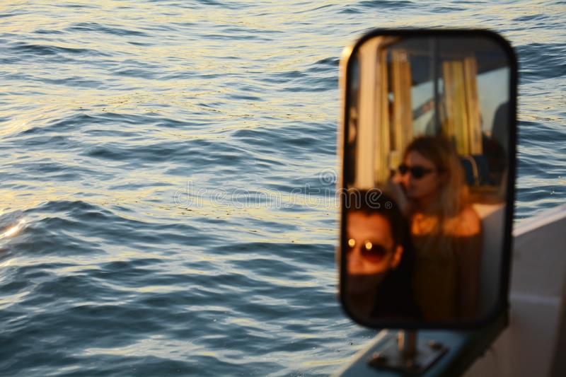 Mirror reflections of travellers stock photo