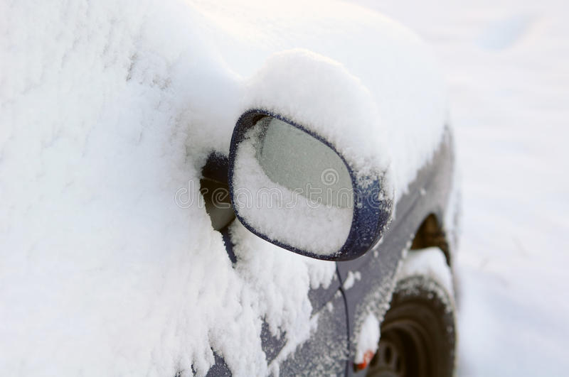 Mirror of snow-covered car royalty free stock photo