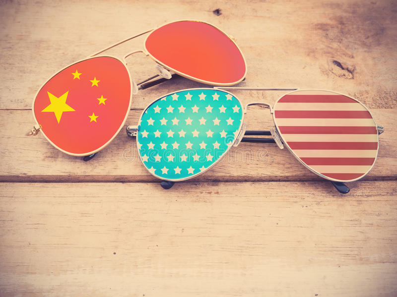 Mirror sunglasses as American and Chinese flag pattern royalty free stock photo