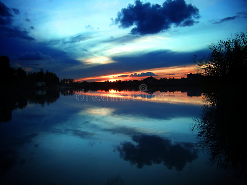 Mirror sunset royalty free stock photography