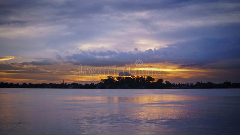 Mirror sunset reflection on the water at Maekhong national river,Thailand. Colorful sky at sunset. Landscape sky at twilight time. Mirror sunset reflection on stock photography