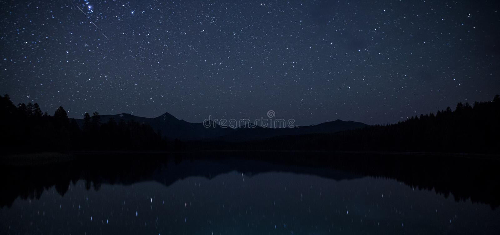 Mirror Surface Lake Breathtaking Landscape With Mountain Range At Night With Sky With Myriads Of Bright Stars royalty free stock images