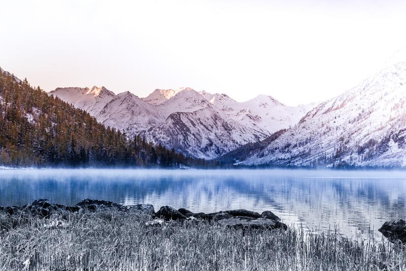 Mirror surface of the mountain lake. Beautiful nature, a trip to the mountains in a national Park in Altai Republic royalty free stock photography