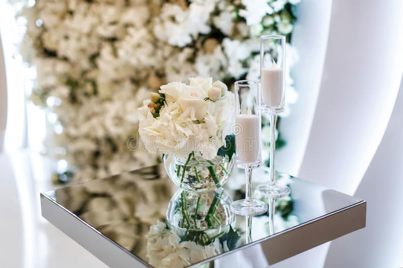 Mirror table with candles on the wedding ceremony place royalty free stock photography