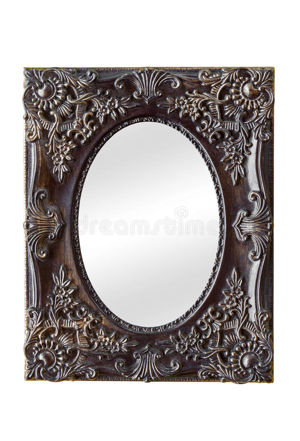 Mirror with vintage decorated frame. Old classic style mirror with vintage decorated frame isolated on white background royalty free stock images