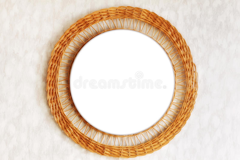 Mirror in wicker frame. Mirror in a wicker frame hanging on the wall royalty free stock photos