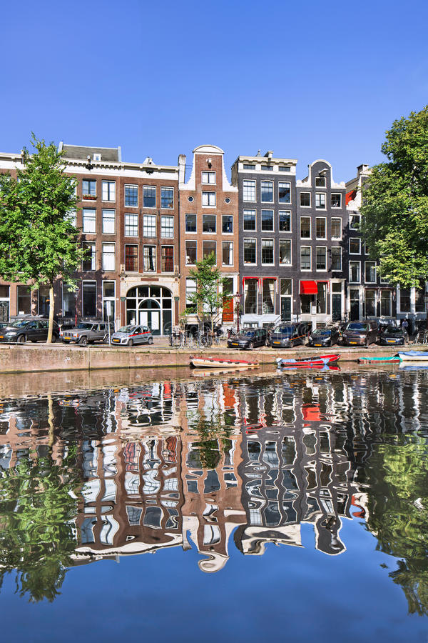 Mirrored ancient mansions at Amsterdam canal belt, Netherlands. royalty free stock images