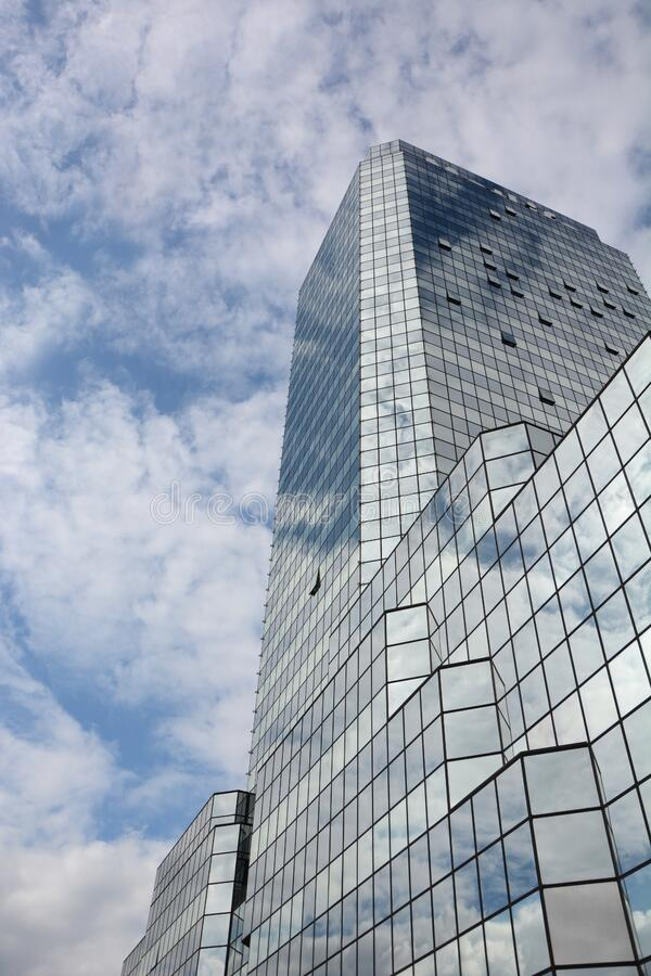 Mirrored building against blue skies stock photo