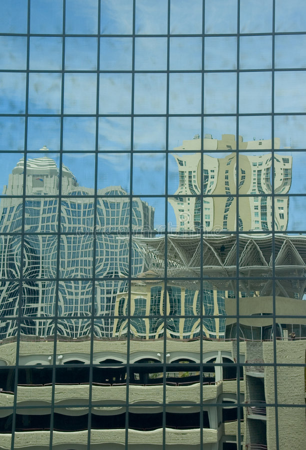Mirrored building with distorted reflection royalty free stock image