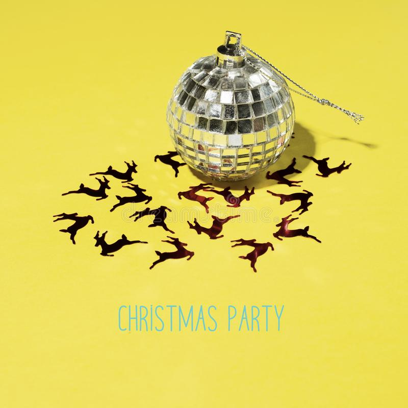 Mirrored christmas ball and text christmas party stock photography