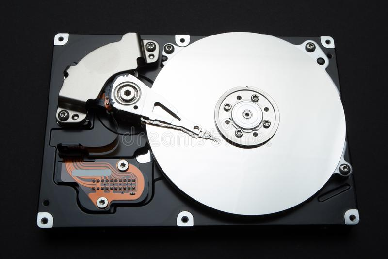 Mirrored hard disk of a computer. The concept of data, hardware and information technology royalty free stock photo