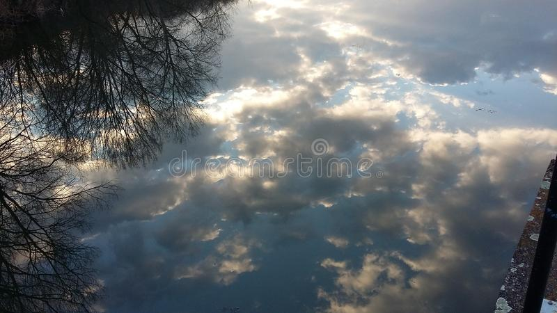 Mirrored sky and clouds in the lake royalty free stock photography