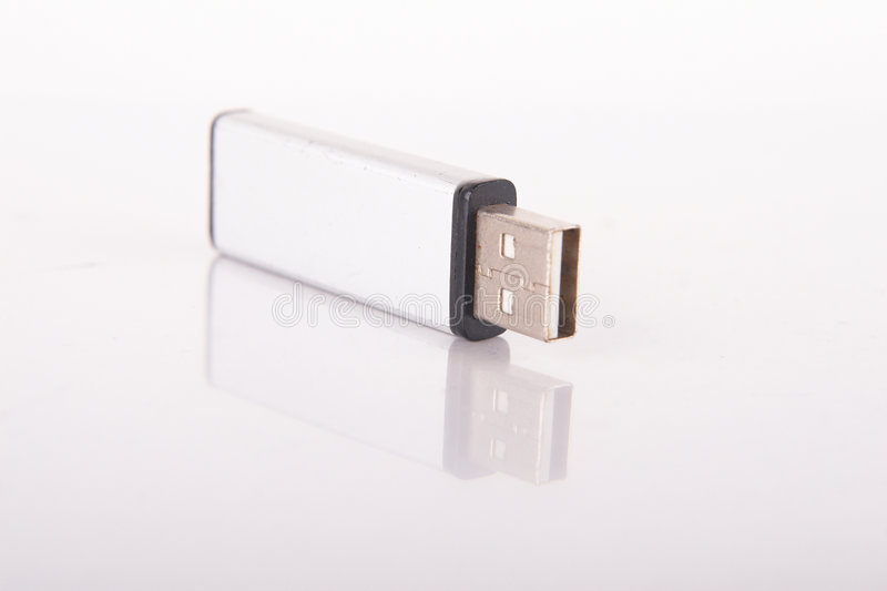 Mirrored USB Stick. Isolated shot of a silver USB stick. The stick is mirrored. Lot of copyspace royalty free stock photos
