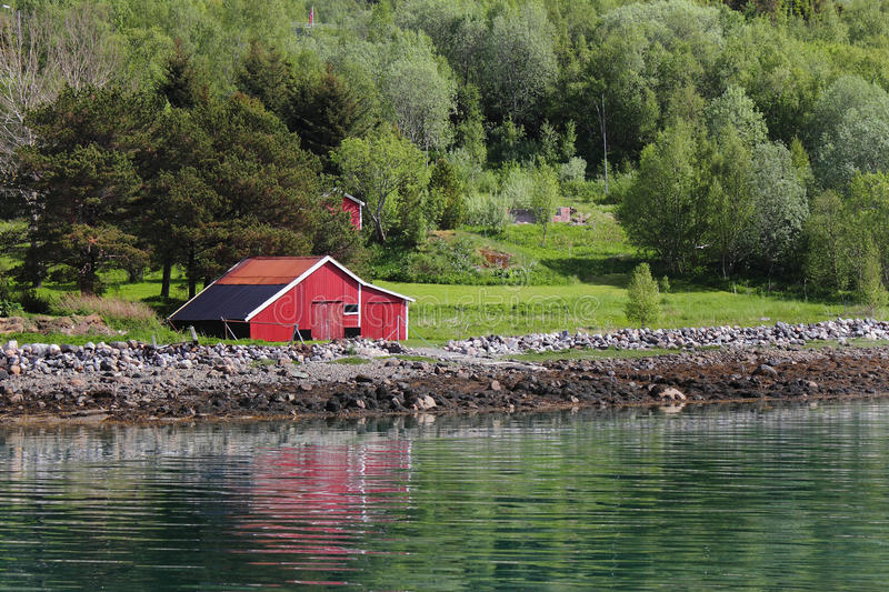 Mirroring cabins of of Meloey. Typical fishermen's and farmers small settlement , Norwegian polar circle stock images