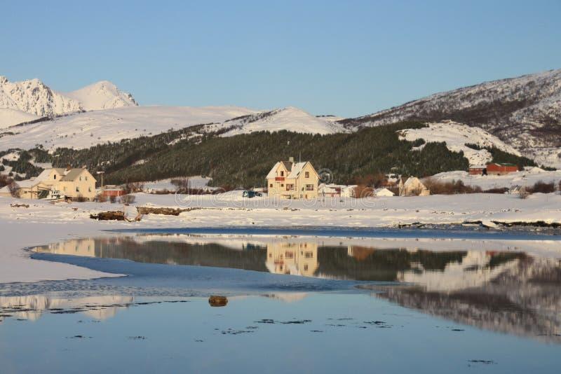 Mirroring in Lofoten's fjord III. Small village mirroring in Mortsund's fjord, Lofoten islands royalty free stock image
