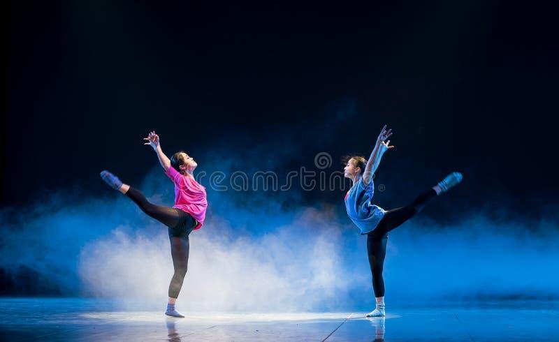 Mirroring-Modern dance. Graduation performance of class5, grade 11, dancing department,Jiangxi Vocational Academy of Art on Dec30,2015 royalty free stock photos
