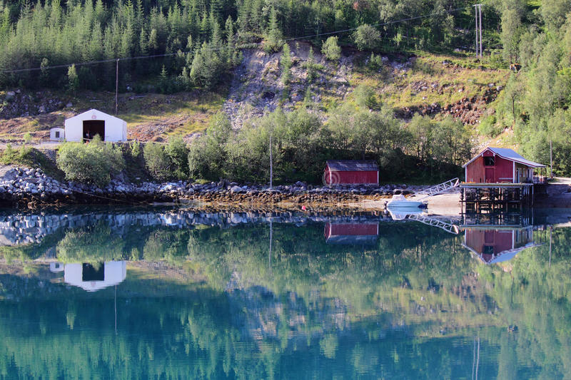 Mirroring pier of of Meloey. Typical fishermen's and farmers small settlement , Norwegian polar circle stock image