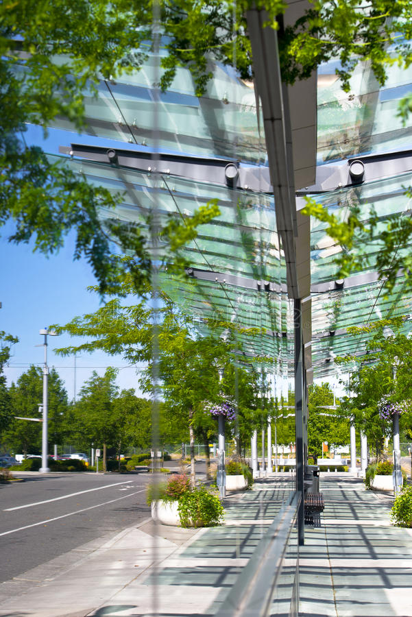 Mirroring the streets in the glass walls of modern building stock images