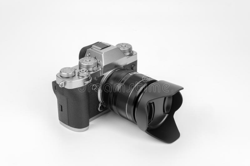 Mirrorless black Camera. View of a Mirrorless black camera isolated on a white background royalty free stock photo
