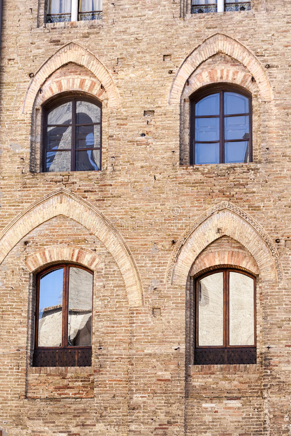 Mirrors. Beautiful facade of a palace in italy with mirrored glass windows royalty free stock photography