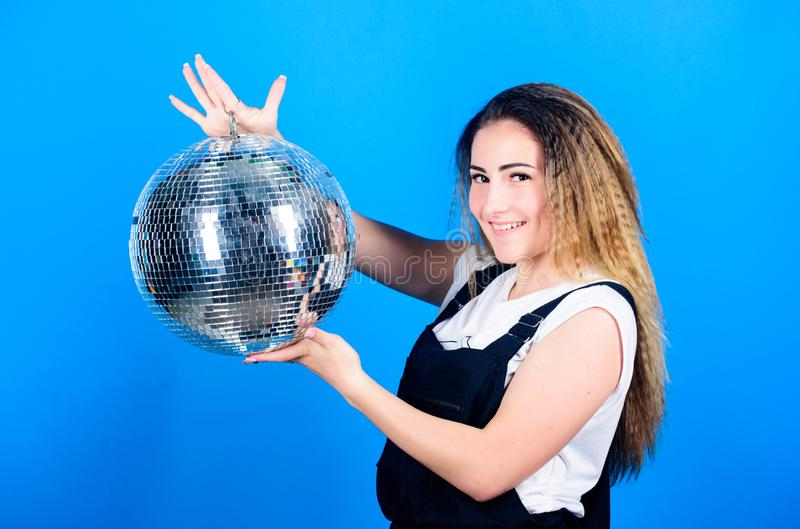Mirrors reflecting lights disco atmosphere. How about party. Little party never killed nobody. Dance until drop. Cheerful woman hold disco ball. Night club royalty free stock photography