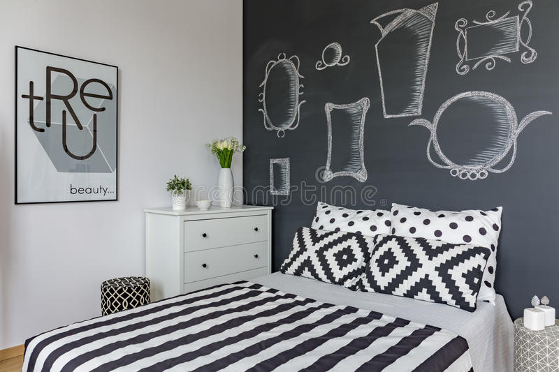 Mirrors on the wall. Mirrors draw on the blackboard above the big bed in bedroom royalty free stock photos