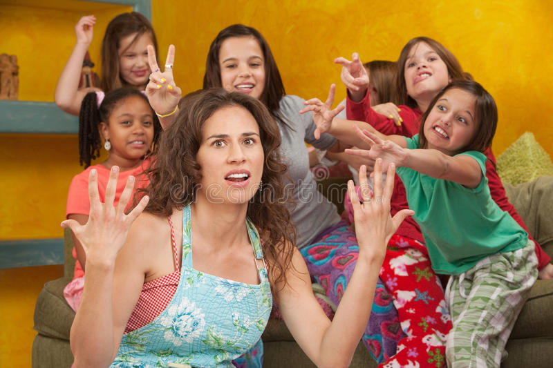 Misbehaving Little Girls With Nanny royalty free stock photo
