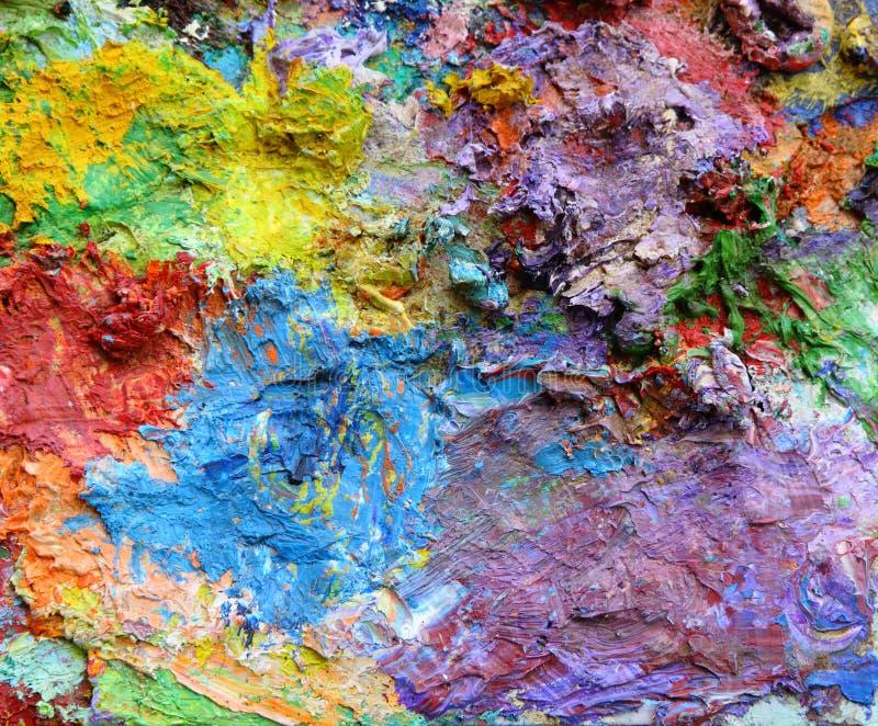 Mischende Ölfarben auf einer Palette stockbild