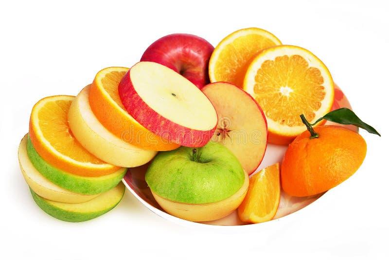 Mischfruchtscheiben, orange und grüner Apfel der frischen Obstsalat-, Apple-Birne stockfotos
