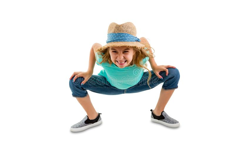 Mischievous naughty little girl bending forwards royalty free stock photography
