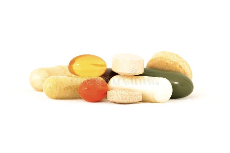 Mischung der Vitaminergänzungen stockfotografie