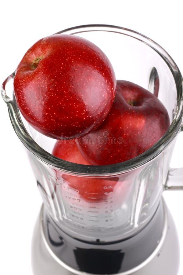 Mischmaschine mit Apfel stockfotografie